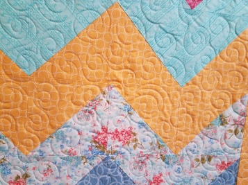 Curls on a custom quilt by Vicki Holloway